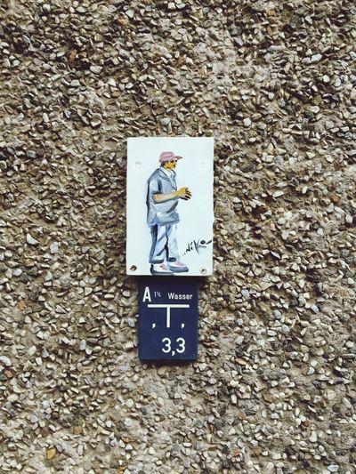 Wasser Male Likeness Human Representation Female Likeness Communication Text Day Mail No People Outdoors Close-up Graffiti Graffiti Art Painting Framed Graffiti Paintings Nailed Permanent Installation Wood Canvas