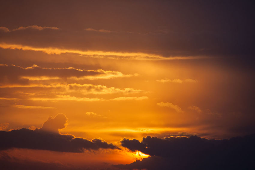Beauty In Nature Cloud - Sky Day Idyllic Mountain Nature No People Orange Color Outdoors Scenics Silhouette Sky Sun Sunlight Sunset Tranquil Scene Tranquility Yellow