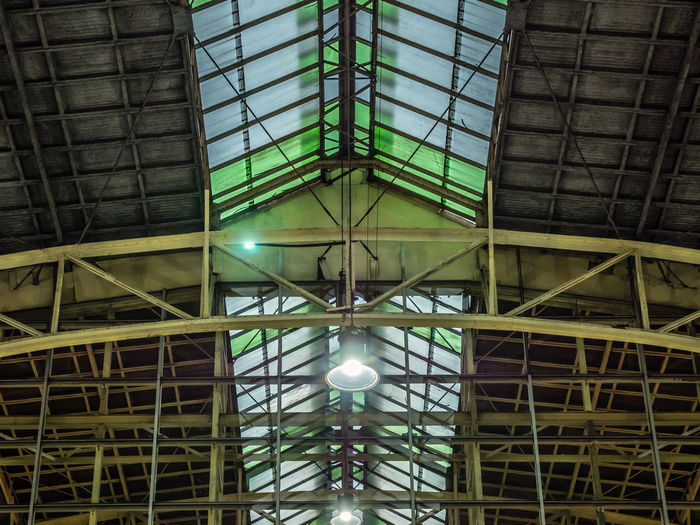 Construction Industrial Industry Architecture Building Built Structure Ceiling Electric Lamp Electricity  Factory Frame Glass - Material Glowing Hanging Illuminated Indoors  Iron - Metal Light Lighting Equipment Low Angle View Metal Pattern Roof Beam Steel Structure  Structure