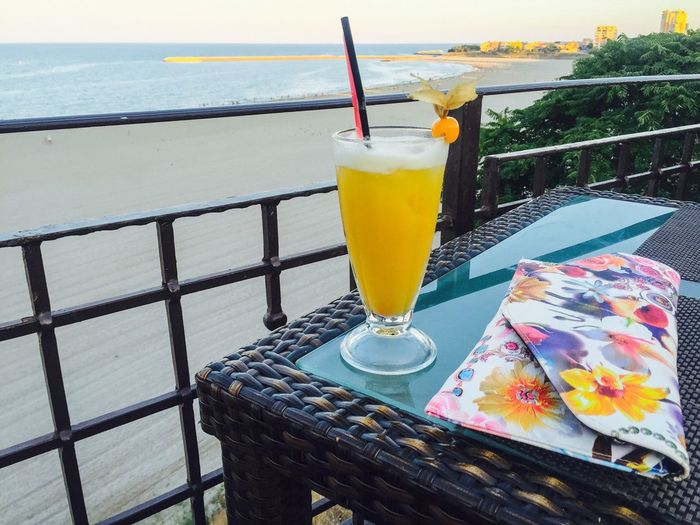 Food And Drink Drink Refreshment Sea Freshness Alcohol Water Railing Piña Colada Beach Bar Summer Drink Smoothie Woman Purse Summer Serving Size Tray No People