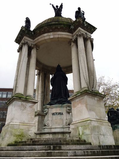 Queen Victoria Queenvictoria Statue Human Representation Sculpture Low Angle View Art And Craft Male Likeness History Outdoors No People Architectural Column Sky Day Built Structure Travel Destinations Architecture Craft Monument