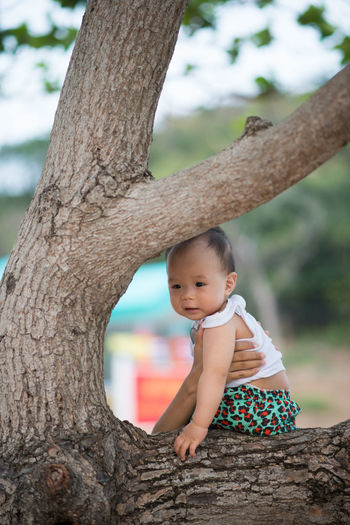 Babies Only Baby Babyhood Beauty In Nature Child Childhood Day Kid Nature One Person Outdoors People Tree Tree Trunk