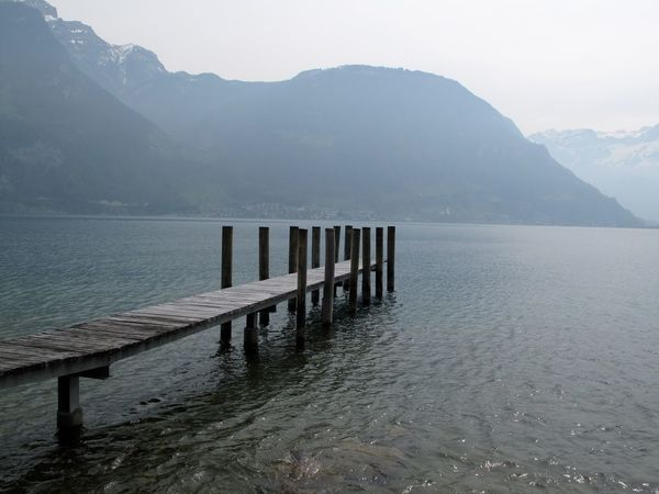 Beauty In Nature Calm Day Idyllic Jetty Lake Majestic Mountain Mountain Range Nature No People Non Urban Scene Non-urban Scene Ocean Outdoors Pier Remote Rippled Scenics Sky Tranquil Scene Tranquility Water Wood - Material Wooden Post