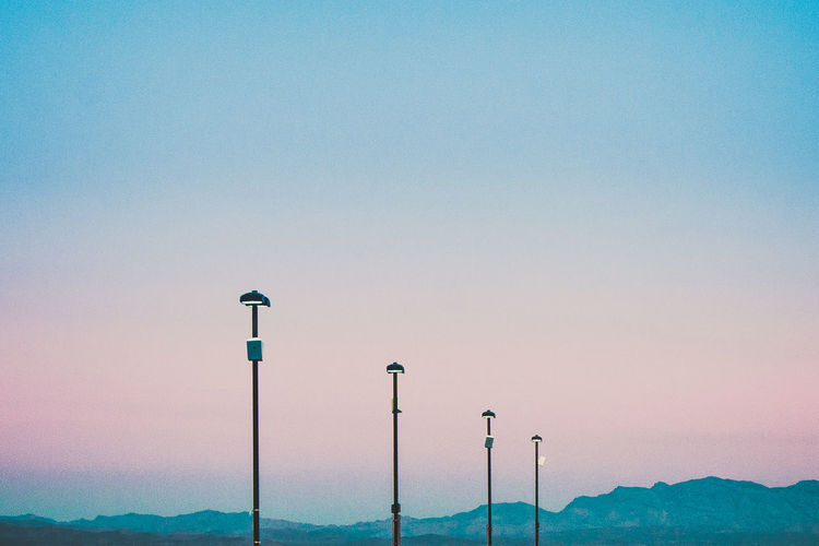After Sunset Blue Hour Clear Sky Cotton Candy Colors Four Group Group Of Objects Minimal Mountain Mountains Nature No People Order Outdoors Sky Street Lights Tranquility