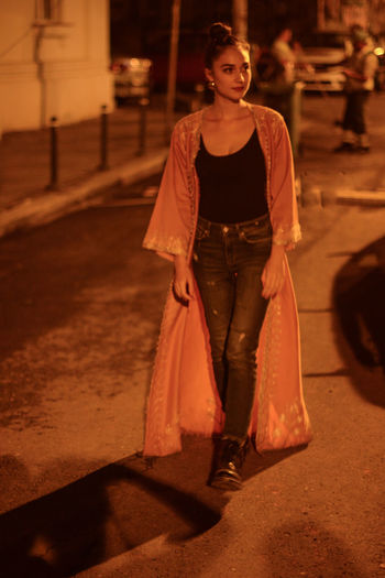 Clothing Dress Fashion Front View Lifestyles One Person Standing Walking Walking Alone... Young Adult HUAWEI Photo Award: After Dark Nightlife Street Delivery Night Illuminated Real People Street Photography Romanian Girl Night Lights Bucureşti Young Woman Determined Orange