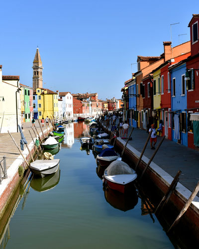 Burano, Venice Church Tower Colourful Venice, Italy Architecture Boats Building Exterior Built Structure Burano Canal Clear Sky Colourful Buildings Gondola - Traditional Boat Italy Nautical Vessel No People Sky Transportation Venice Water Waterfront