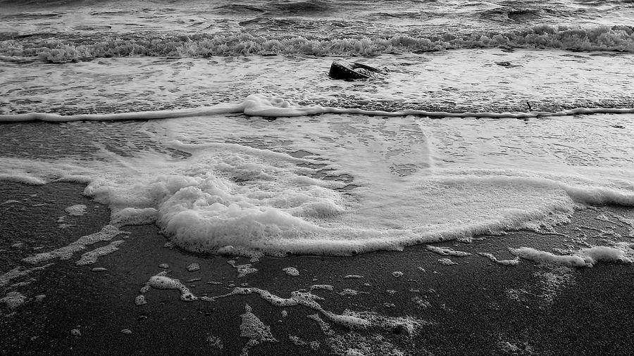 Waves reaching shore at beach