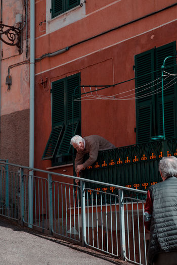 SIGNORE Elderly Man Old Man Portrait Of An Old Man Portrait Portrait Photography Architecture And People Windows Clean Cleaning Dusting Old Man Elderly Man Italy Cinque Terre Building Exterior Architecture Built Structure Gate