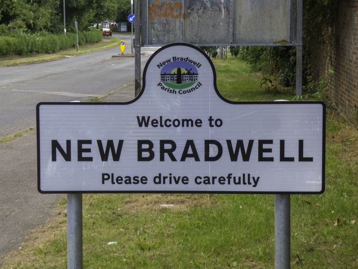 Close-up of information sign on road