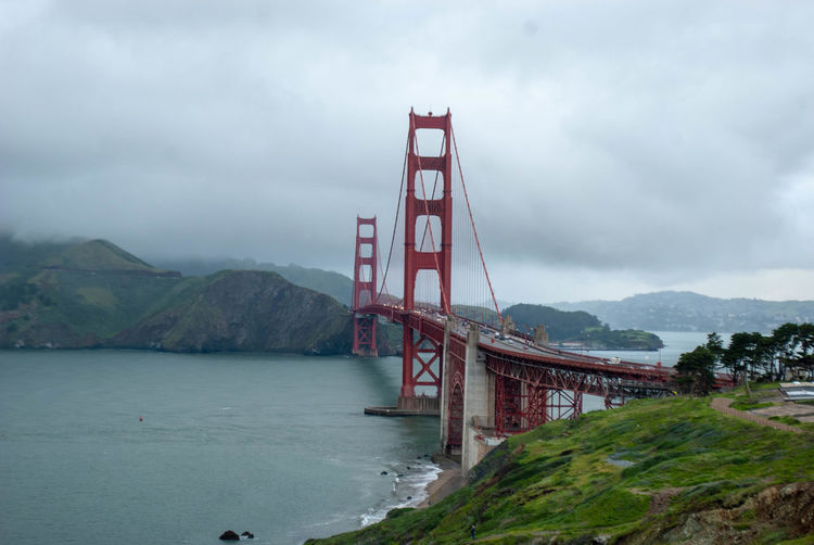Bridge - Man Made Structure Bridge Built Structure Suspension Bridge Sky Architecture Engineering Water Cloud - Sky Bay Transportation Travel Destinations Connection Nature Mountain Bay Of Water Day Travel Outdoors Golden Gate Bridge