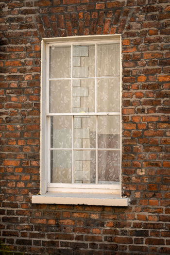 Window on brick wall of building