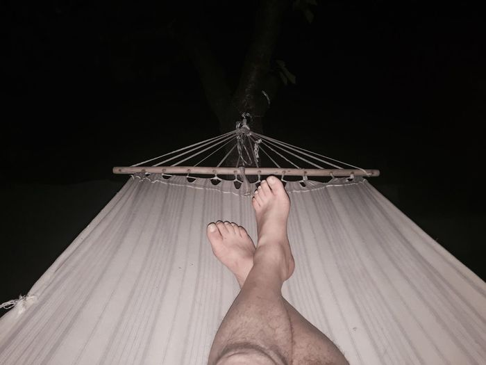 Low Section Of Man Lying In Hammock