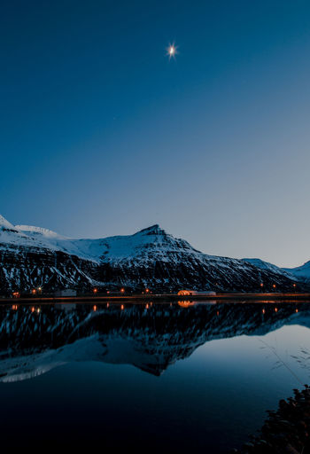 iceland in a mirror Iceland Mountain Landscape Crescent Moon Water Mountain Snow Illuminated Moon Clear Sky Lake Reflection Blue Snowcapped Mountain Planetary Moon Frozen Winter The Great Outdoors - 2018 EyeEm Awards