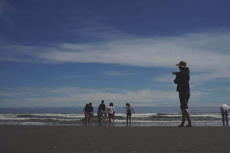 Beach Sea Sand Sky Nature Water Lifestyles Men Real People Leisure Activity Horizon Over Water Outdoors Togetherness Vacations Standing Scenics Full Length Wave Beauty In Nature Friendship Light And Shadow Silhouette_collection Nature Landscape EyeEm