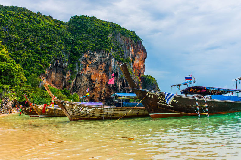Railey Beach Railey Beach - Thailand Beach Beauty In Nature Cloud - Sky Day Longtail Boat Longtailboat Mode Of Transport Moored Mountain Nature Nautical Vessel Outdoors Real People Rock - Object Scenics Sea Sky Tranquility Transportation Tree Water Waterfront
