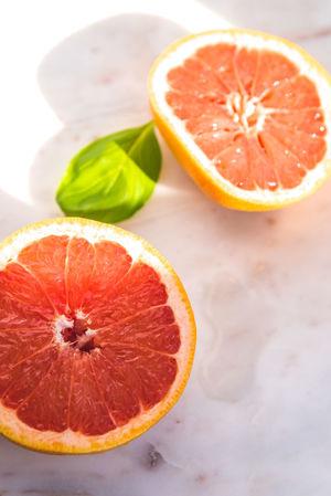 Citrus Fruit Close-up Cross Section Food Food And Drink Freshness Fruit Grapefruit Halved Healthy Eating Indoors  Juicy No People Orange Orange - Fruit Orange Color Ripe SLICE Still Life Table Wellbeing