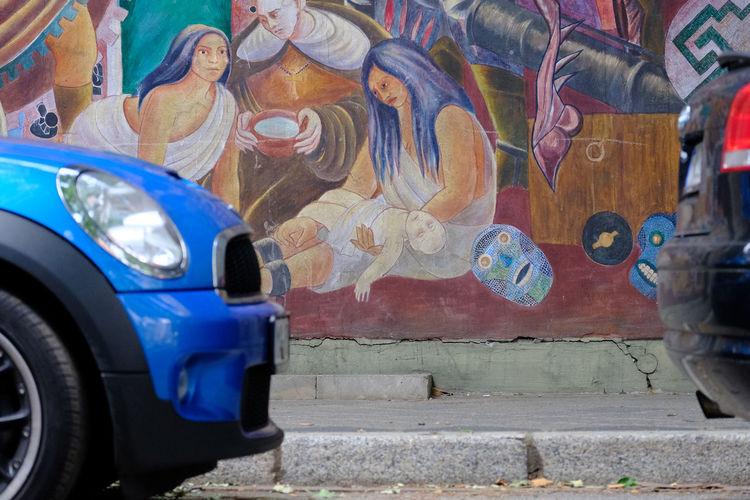 the gap Blue Bumper Car Child Christmas Close-up Colors Day Gap Graffiti Hidden In Plain Sight Inbetween Jesus Land Vehicle Lying Down Madonna Outdoors Street Streetart Transportation