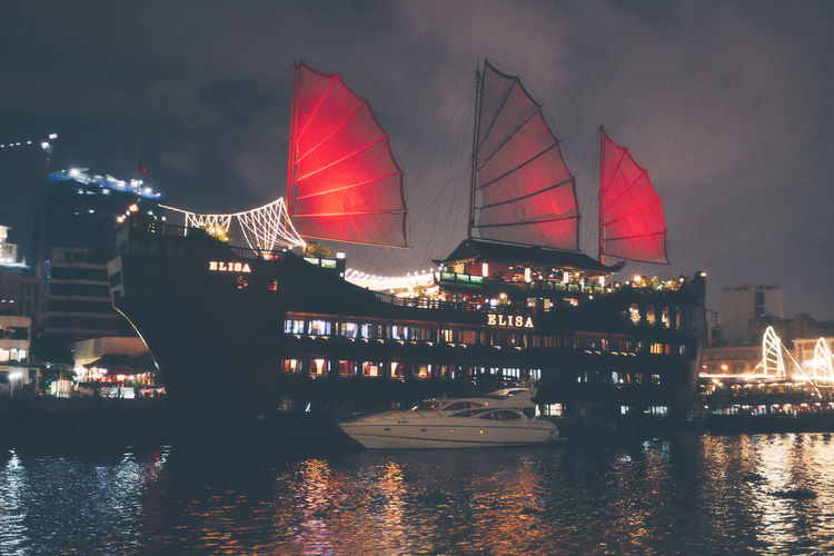 Passenger liner At Night In Vietnam. Vietnam Architecture Bay Boat Building Exterior Built Structure City Cruise Line Flag Illuminated Mode Of Transportation Nature Night No People Outdoors Passenger Craft Passenger Liner Reflection River Sailboat Ship Sky Transportation Water Waterfront