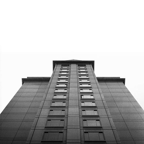 Buildings, so tall. Shot with a Hasselblad 500C, Ilford Delta 400, developed locally, scanned personally. Thedarkroomlab_bwfilm Hasselblad Hasselblad500c Film Filmphotography Filmisnotdead Ishootfilm Staybrokeshootfilm Ilforddelta Ilford Christianmurphyphotography Nofilter IGDaily Photographersofinstagram