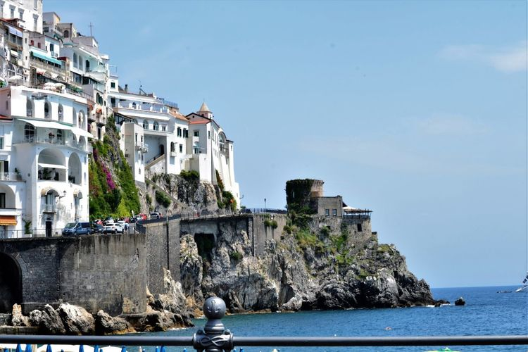 Amalfi Coast Architecture Beauty In Nature Blue Building Building Exterior Built Structure Campania Canal Day Italy Landmarks Nature No People Outdoors Residential Building Residential District Residential Structure Rippled Sea Sky Turismo Water