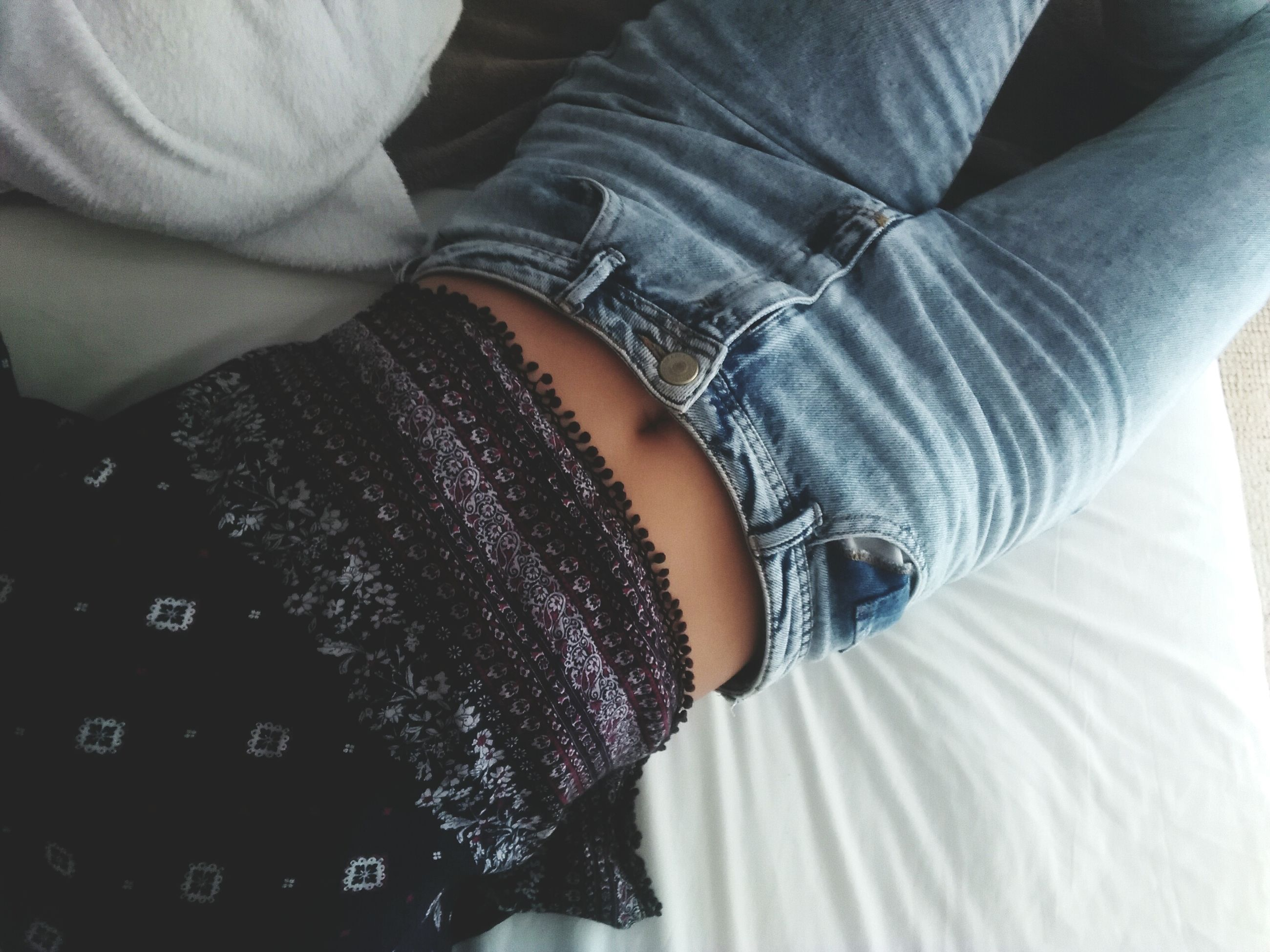 indoors, lifestyles, person, low section, casual clothing, midsection, leisure activity, bed, men, high angle view, part of, jeans, close-up, holding, mid section