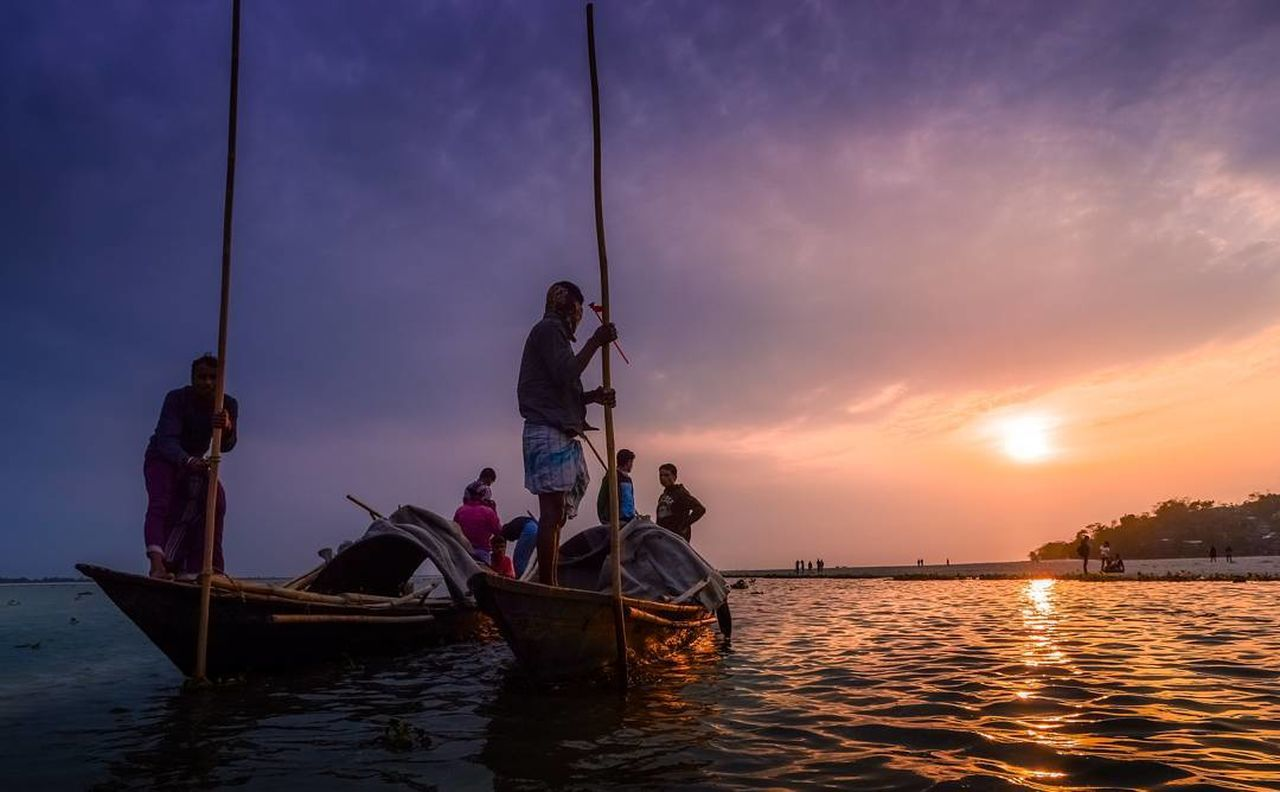 transportation, nautical vessel, sunset, water, mode of transport, sea, real people, men, nature, outdoors, fisherman, sky, waterfront, women, scenics, beauty in nature, togetherness, standing, lifestyles, night, longtail boat, people