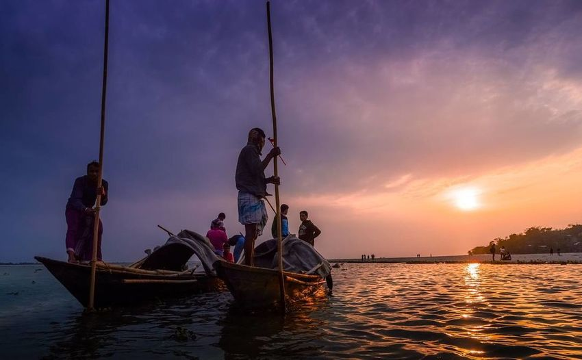 Nautical Vessel Sunset Religion Fisherman Spirituality Fishing People Adult Travel River Tradition Ship Cloud - Sky Arrival Outdoors Landscape Water Night Men Longtail Boat Resist EyeEm Diversity The Secret Spaces Long Goodbye EyeEmNewHere