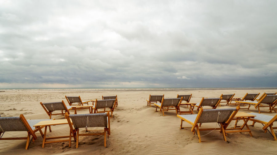 Summer cloudy day at the beach Cloud Deck Chair Beach Cloud - Sky No People Outdoors Sand Sea Sea And Sky
