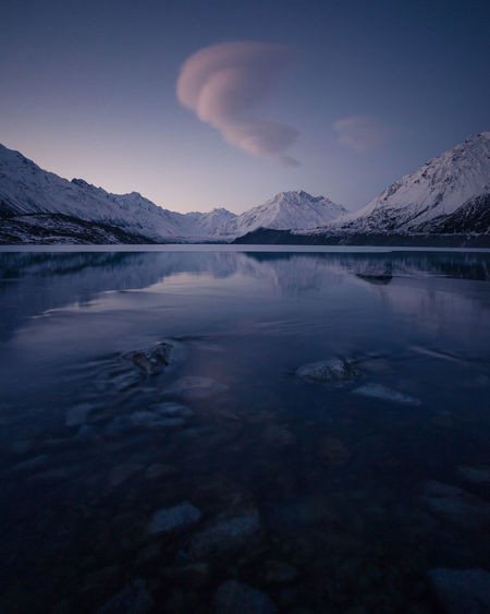 Beauty In Nature Cloud - Sky Cold Temperature Idyllic Lake Mountain Mountain Range Nature No People Non-urban Scene Reflection Scenics - Nature Sky Snow Snowcapped Mountain Tranquil Scene Tranquility Water Waterfront Winter