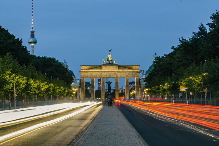 Berlin, Germany, August 31, 2018: Traffic on Strasse Des 17. Juni with Brandenburg Gate in Background at Dusk Berlin Germany 🇩🇪 Deutschland Horizontal No People Outdoors Color Image Architecture Built Structure Tree Building Exterior Sky Plant Light Trail Straße Des 17. Juni Brandenburg Gate TV Tower Communications Tower Dusk Twilight Evening Alley Copy Space Famous Place Tail Light Headlight