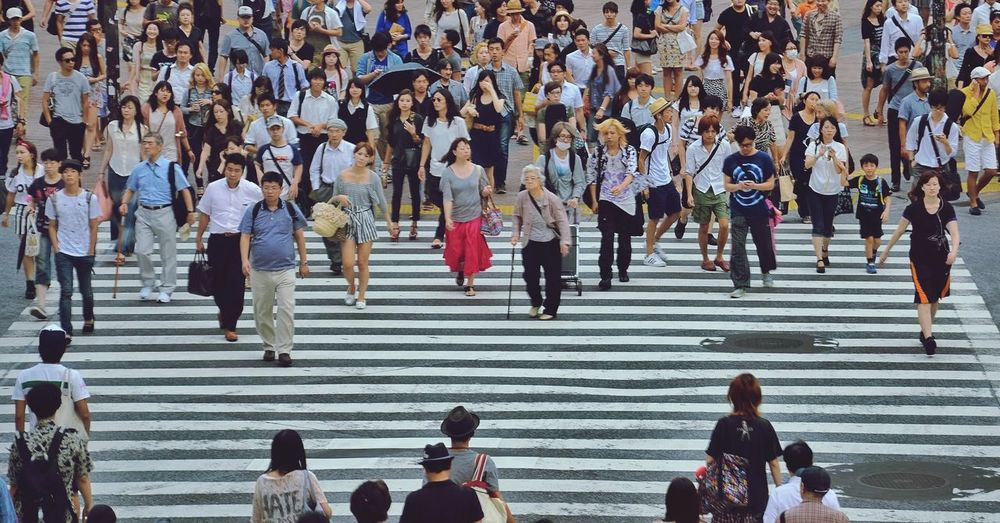 High angle view of people on zebra crossing in city