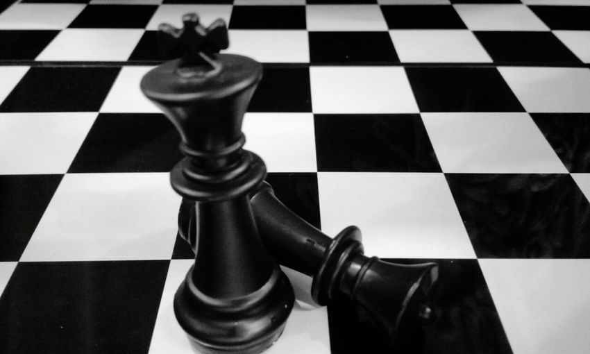 Chess Checked Pattern Chess Board Chess Piece Competition Strategy Leisure Games Black Color High Angle View Winning King - Chess Piece Defeat Indoors  No People Conflict Close-up Knight - Chess Piece Sports Race Queen - Chess Piece Finish Line