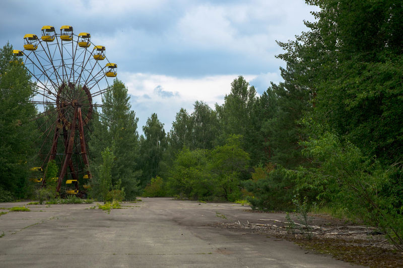 The Pripyat amusement park is an abandoned amusement park in Pripyat, Ukraine. It was to be opened for the first time on May 1, 1986, in time for the May Day celebrations, but these plans were scuttled on April 26, when the Chernobyl disaster occurred a few kilometers away. Abandoned Place Dark Tourism Ferris Wheel Nuclear Catastrophy Pripyat Pryp'jat' Ukraine Ukranian  Amusement Park Big Wheel Chernobyl Nuclear Disaster Nuclear Power Plant Symbol Tour