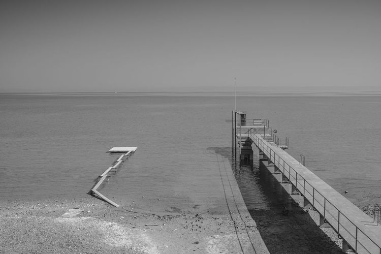 chantier des songe-creux The Minimalist - 2019 EyeEm Awards The Traveler - 2019 EyeEm Awards The Great Outdoors - 2019 EyeEm Awards Tranquility Scenic View Shore Idyllic Foggy Landscape Horizon Over Water Sky Sand Dune Clear Sky Sand Beach Water Lake Of Constance Thurgau EyeEm Nature Lover Remote Monochrome Blackandwhite Betterlandscapes Scenics Calm Poetic Beauty In Nature Jetty Lake View Lake Gry Et L'aventure