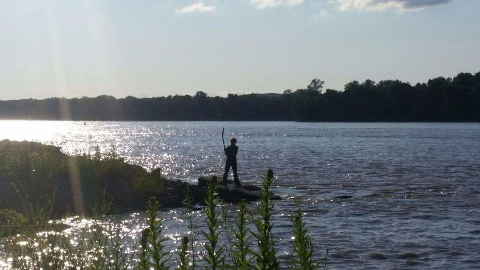 Boy Child Taking Photos Land And Sky Land Sky And Water Scenery River Mississippi  Mississippi River Land And Water Water And Sky Silouette & Sky Sillouette Silhouette Playing