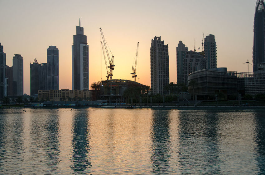 Architecture Building Exterior Buildings Built Structure City Connection Dubai Engineering Famous Place Fountain International Landmark Outdoors Sunset Tower