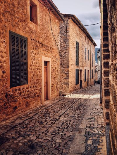 Street in Biniaraix, Mallorca, Spain Mallorca Traveling Travel Photography Travel Travel Destinations Street Biniaraix SPAIN Village Building House Cobblestone No People The Architect - 2016 EyeEm Awards