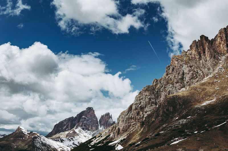 Cloud - Sky Mountain Sky Beauty In Nature Scenics - Nature Mountain Range Rock Winter Tranquil Scene Cold Temperature Day Nature Tranquility Non-urban Scene Snow Low Angle View Rock - Object Solid Environment No People Snowcapped Mountain Outdoors Formation Mountain Peak Landscape