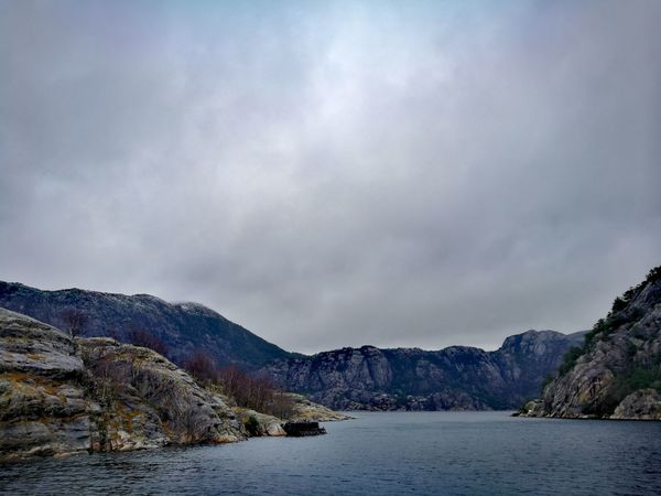 Mountain Outdoors Landscape No People Mountain Range Nature Day Beauty In Nature Sky Lysefjord Norway Beauty In Nature Atmospheric Mood Cloud - Sky Tranquil Scene Tranquility Travel Destinations Sea Scenics Blue Nature Water