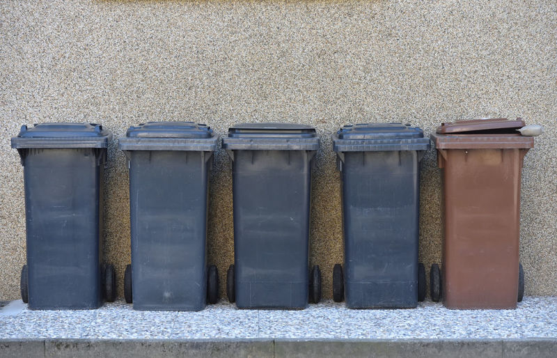Trash cans against the wall