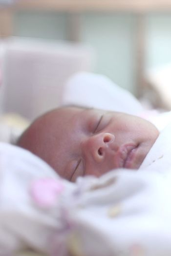 ISO 3200 Nikon D5200 + Nikon 35 f/1.4 AF-S, over exposed Bandung Shooter Indonesian Shooter Baby Young Child Childhood Newborn Innocence Lying Down Beginnings New Life Babyhood One Person Indoors  Selective Focus Vulnerability  Real People Cute Fragility Bed Capture Tomorrow