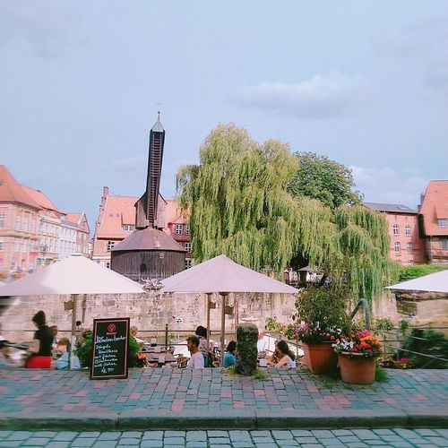 Peaceful Cafe Near The Water Really Big Tree Beautiful Weather Beautiful City Lüneburg Germany People In Cafe Short Trip Smartphonephotography With A Broken Camera Neighborhood Map