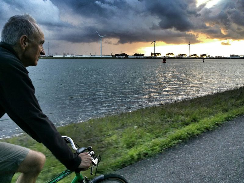 Canal sunset Holland Towpath Cycling One Man Only Outdoors Sea Cloud - Sky Sunset Evening Sky Dramatic Sky The Week On EyeEm