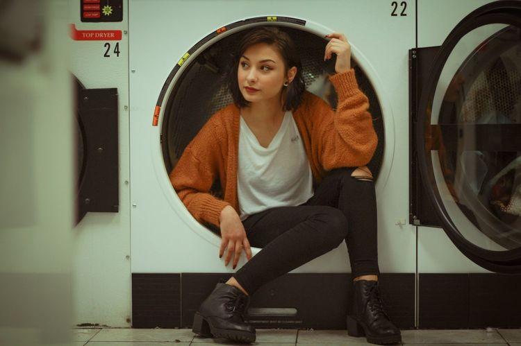 Laundry day Washing Machine Sitting Portrait Casual Clothing Lifestyles Laundromat Domestic Life