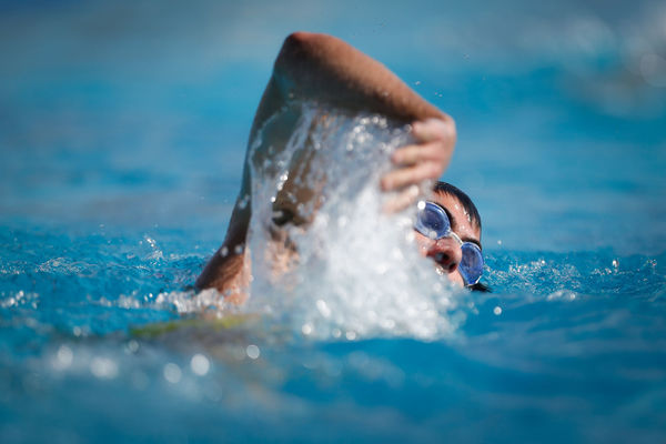 A man swims in a swimming pool Action Argentina Competition Day Perso Pool Sport Swim Swimming Water Waterpolo Wet