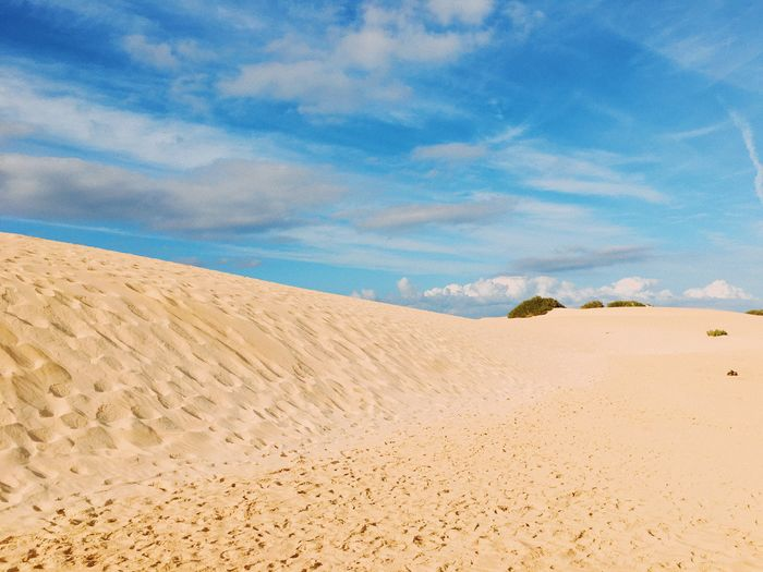 Sand Land Scenics - Nature Sky Beauty In Nature Landscape Tranquility Desert Environment Nature Tranquil Scene Non-urban Scene Cloud - Sky Climate No People Blue Outdoors Day Sand Dune Arid Climate