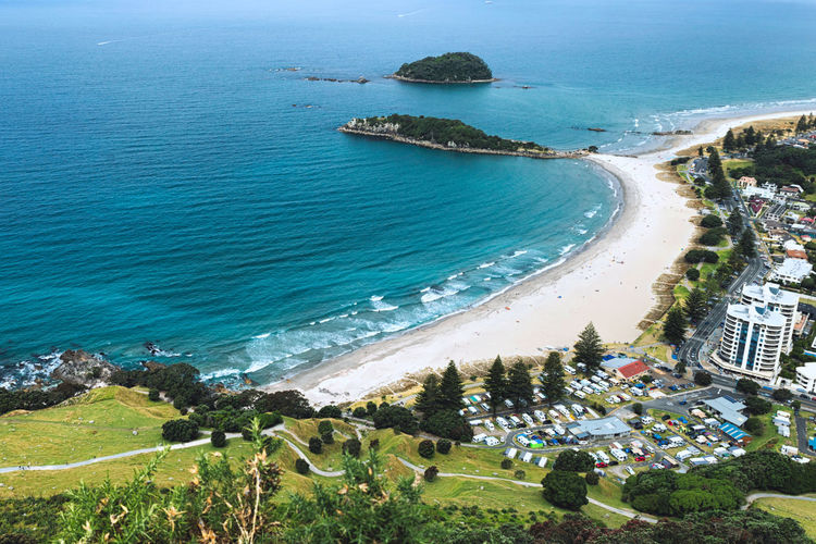 View of the beautiful beach in Mount Maunganui, New Zealand Water Sea High Angle View Land Beach Nature Plant Scenics - Nature Coastline City Travel Destinations Beauty In Nature Mountain New Zealand