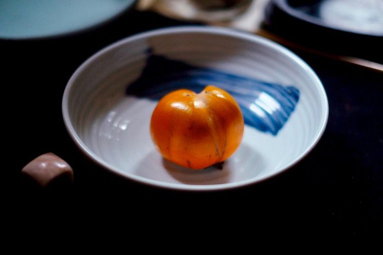 High angle view of persimmon in bowl on table