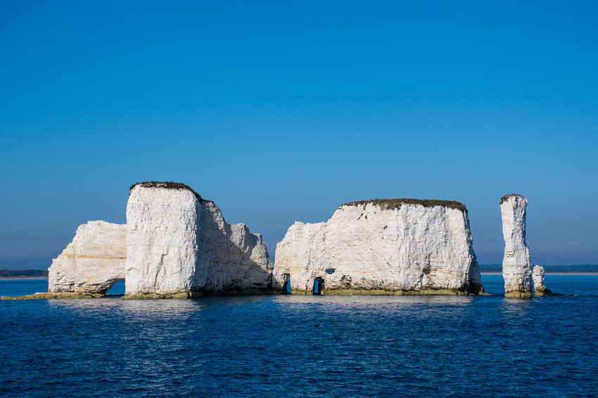 Old Harry rocks on Dorset Coast Water Sea Beauty In Nature Tranquil Scene Scenics - Nature Rock - Object Rock Formation Stack Rock Old Harry Rocks Old Harry Cliffs Nature Clear Sky Cliff Horizon Over Water Idyllic