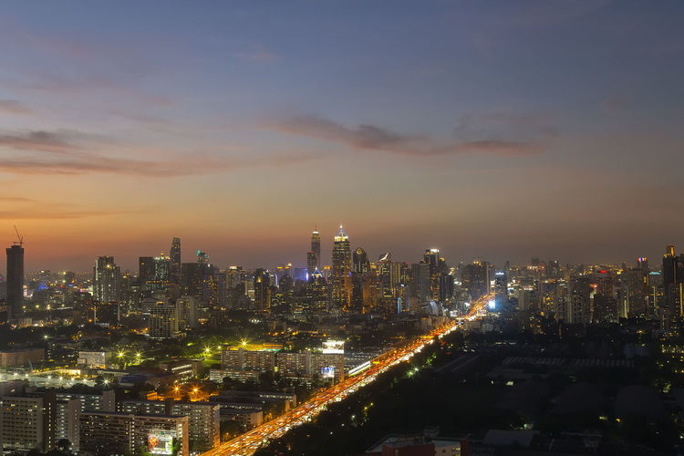Panorama of landscape with sunset over the building and blue sky at bangkok ,thailand.